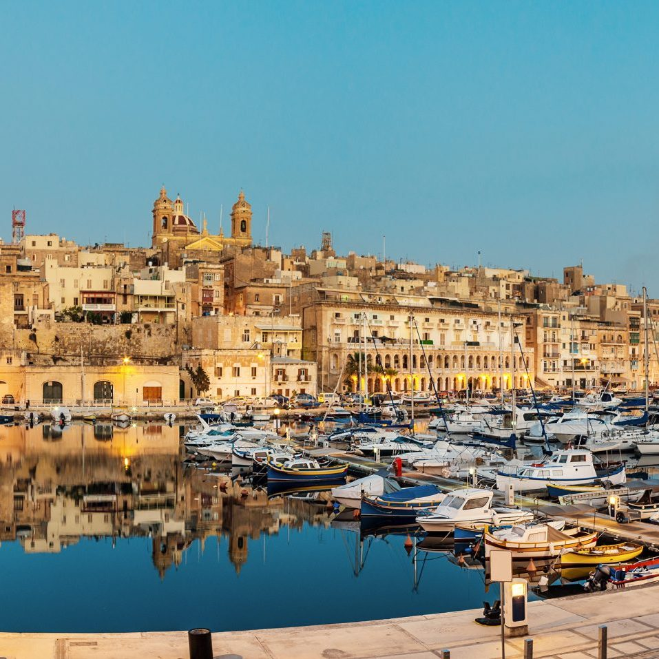 Panorama wth sailing boats on Senglea marina in Grand Bay, Valetta, Malta, on a quiet evening. This image is toned.